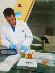 A pharmacy resident handles some of the take. (Photo provided by John Dobbins)