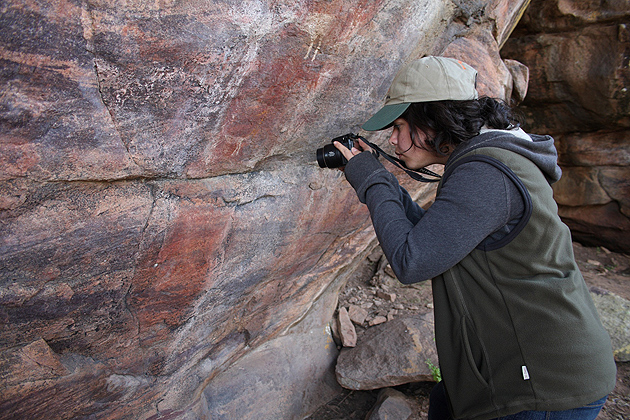 Aileen Leask takes photos of rock art in South Africa. (Lee Gutteridge/Entabeni Game Reserve Photo)