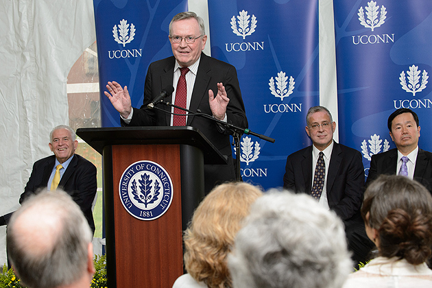 Philip Austin, president emeritus, speaks at a ceremony to mark the naming of the Philip E. Austin Building on Oct. 3. Seated from left are Lawrence McHugh, chair of the Board of Trustees, Jeremy Teitelbaum, dean of the College of Liberal Arts and Sciences, and Mun Choi, interim provost. (Peter Morenus/UConn Photo)