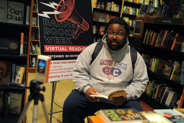 Taurean Stovall '13 (SFA) reads from John Steinbeck's 'Of Mice and Men' during Banned Books Week at the UConn Co-op in 2012. (Max Sinton/UConn Photo)