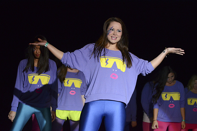 Students from Delta Zeta, Pi Kappa Alpha, and Tau Kappa Epsilon perform to Lady Gaga songs at Lip Sync, part of the 2012 Homecoming celebration(Ariel Dowski/UConn Photo)