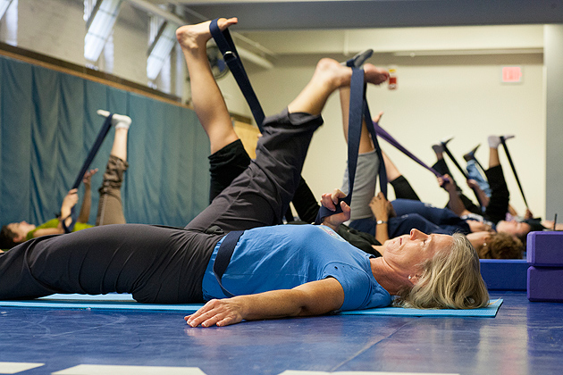 Free yoga classes at Hawley Armory are among the programs offered by UConn's Department of Human Resources and the Work/Life Oversight Committee during October, to mark National Work & Family Month. (Sean Flynn/UConn Photo)