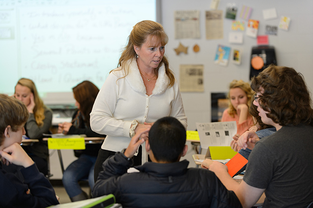 Karen Cordero, an earth science teacher at Bolton High School leads her class in a simulated county planning meeting on Nov. 28, 2012. (Peter Morenus/UConn Photo)