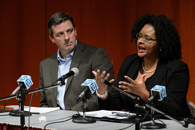 Shayla Nunnally, associate professor of Political Science, right, speaks during a panel discussion on election results at Konover Auditorium on Nov. 7, 2012. At left is Vincent Moscardelli. (Peter Morenus/UConn Photo)