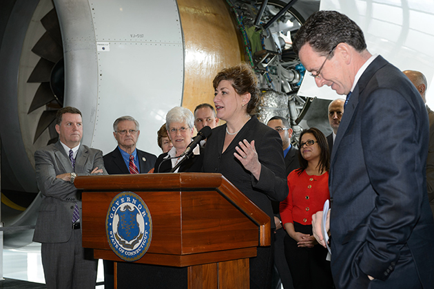 Gov. Malloy, right, and other dignitaries listen as President Susan Herbst speaks about the Next Generation Connecticut initiative. (Peter Morenus/UConn Photo)