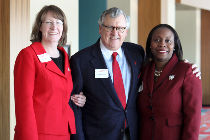Dr. Anita Kelsey, Dr. Stephen Lahey, and Dr. Anjanette Ferris at the Greater Hartford Go Red for Women event at the Hartford Convention Center on February 14, 2013. (Sarah Turker/UConn Health Center Photo)