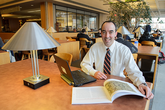 Brendan Kane, associate professor of history, in the reading room of the Homer Babbidge Library on Feb. 7, 2013. (Ariel Dowski/UConn Photo)