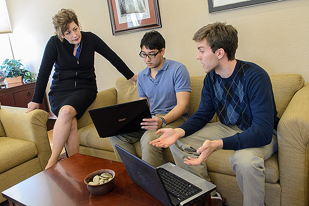 President Susan Herbst talks with Surav Sakya '13 (CLAS), middle, and Garrett Rapsilber '13 (CLAS) during her office hours in Albert Gurdon Gulley Hall on Feb. 18, 2013. (Ariel Dowski/UConn Photo)