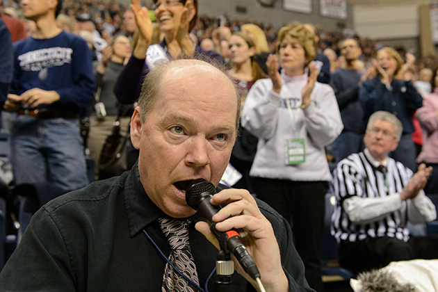 Public address announcer John Tuite calls out the names of players during the Senior Night ceremony at the start of the women's basketball game against Seton Hall at Gampel Pavilion on Feb. 23. (Peter Morenus/UConn Photo)