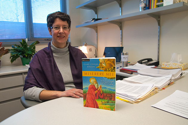 Clare Costley Kingo'o photographed with her Book, Miserere Mei, witch she received the Book of the Year award from Conference on Christianity and Literature on Jan. 24, 2013. (Sean Flynn/UConn Photo)