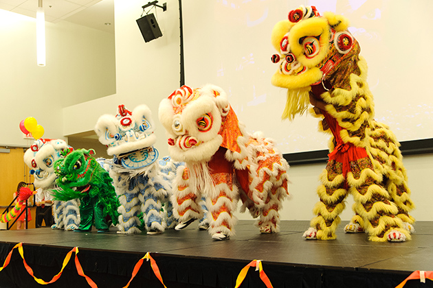 Members of the Hong Tinh Duong Lion Dance Team perform at the Lunar New Years Celebration at the Student Union on March1, 2013. (Max Sinton/UConn Photo)