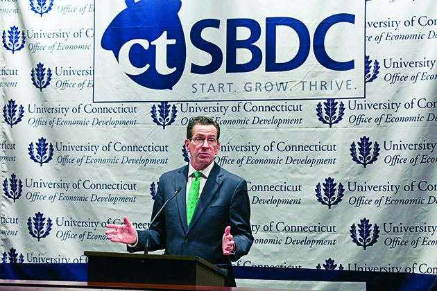 Gov. Dannel P. Malloy speaks about the Connecticut Small Business Development Center as an example of the new partnership between state government and the business community. (Shana Sureck for UConn)