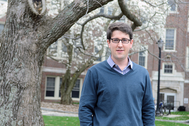 Michael Hren, assistant professor of integrative geoscience, outside of Charles Lewis Beach Hall on April 19, 2013. (Ariel Dowski/UConn Photo)