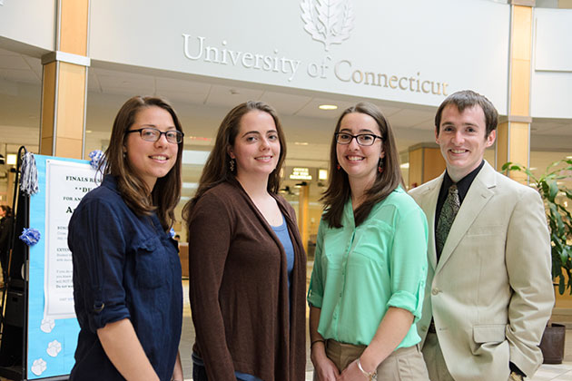 From left, Emily Funk '13 (CLAS), Anna Green '13 (CLAS), Jennifer Bento, a Ph.D. candidate in the polymer program in the Institute of Materials Science, and Tyler Reese '13 (CLAS), in the Wilbur Cross Building. (Ariel Dowski '14 (CLAS)/UConn Photo)