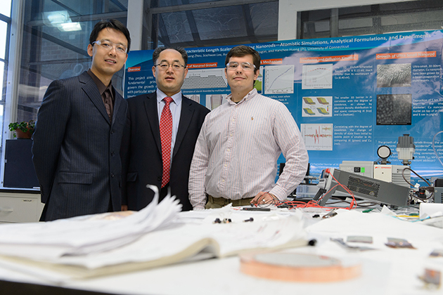 Xiaobin Niu, assistant research professor, left, Hanchen Huang, Connecticut Clean Energy Fund Professor in Sustainable Energy, and Stephen Stagon a doctoral student of mechanical engineering, at their lab at the Longley Building on April 23, 2013. (Peter Morenus/UConn Photo)