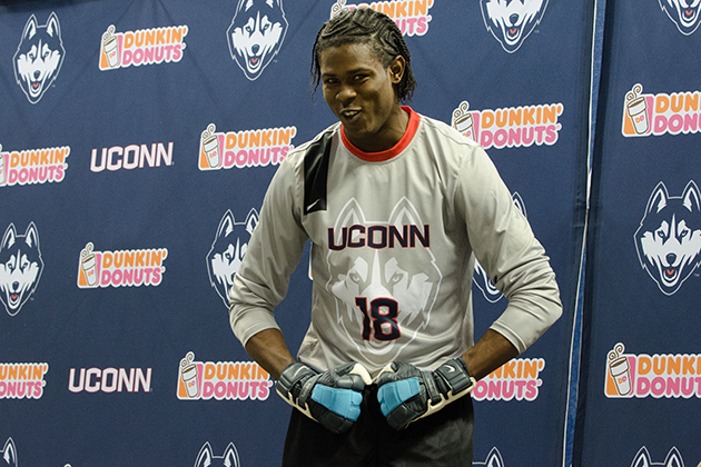 Andre Blake '15 (CLAS) models a new soccer goalie uniform during a ceremony held at Gampel Pavilion on April 18, 2013. (Peter Morenus/UConn Photo)