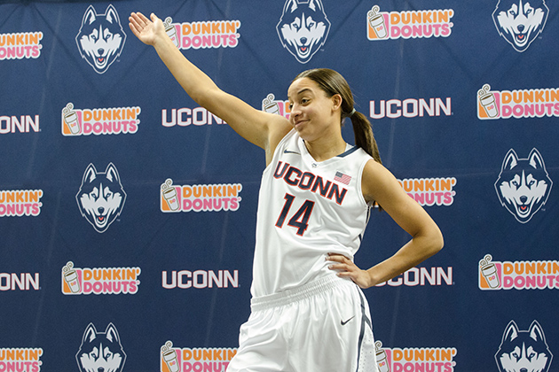 Bria Hartley '14 (CLAS) models a new basketball uniform during a ceremony held at Gampel Pavilion on April 18, 2013. (Peter Morenus/UConn Photo)