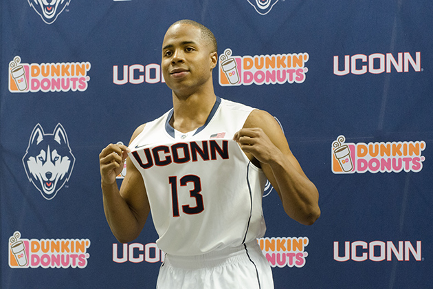 Tor Watts '14 (CLAS) models a new basketball uniform during a ceremony held at Gampel Pavilion on April 18, 2013. (Peter Morenus/UConn Photo)