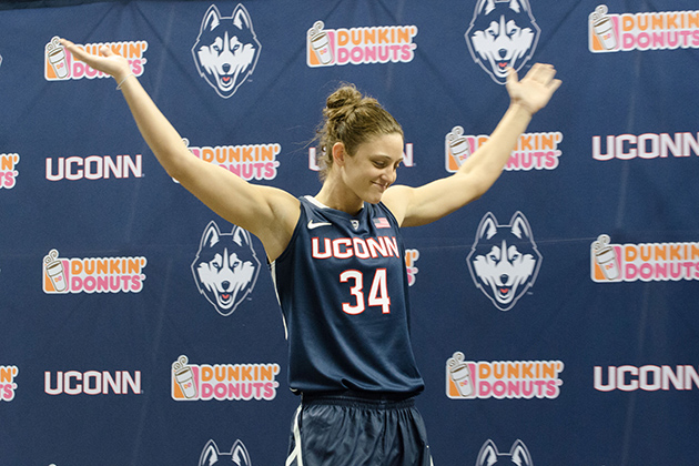 Kelly Faris '13 (CLAS) models a new basketball uniform during a ceremony held at Gampel Pavilion on April 18, 2013. (Peter Morenus/UConn Photo)