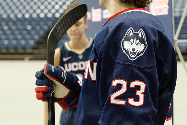 Brant Harris '14 (CLAS) models a new hockey uniform during a ceremony held at Gampel Pavilion on April 18, 2013. (Peter Morenus/UConn Photo