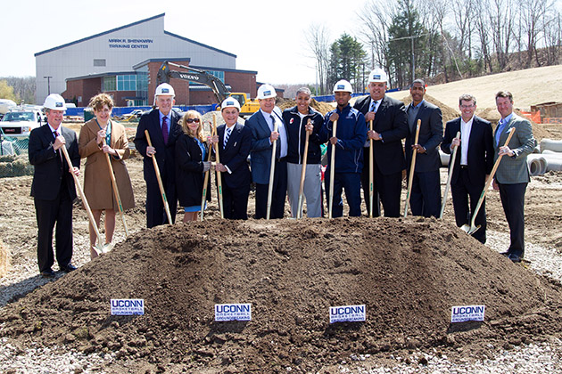 UConn officials and friends celebrate groundbreaking for the University's new basketball practice facility on April 16. From left, UConn supporter Sonny Whelen; President Susan Herbst; Board of Trustees Chairman Larry McHugh; Rosalind Shenkman; UConn Foundation Board of Directors Chairman Mark Shenkman; UConn supporter Peter Werth; women's basketball player Kaleena Mosqueda-Lewis; men's basketball player Ryan Boatright; Athletics Director Warde Manuel; men's basketball head coach Kevin Ollie; women's basketball head coach Geno Auriemma; and UConn Foundation Board of Directors Member Robert Skinner. (Steve Slade '89 (SFA) for UConn)