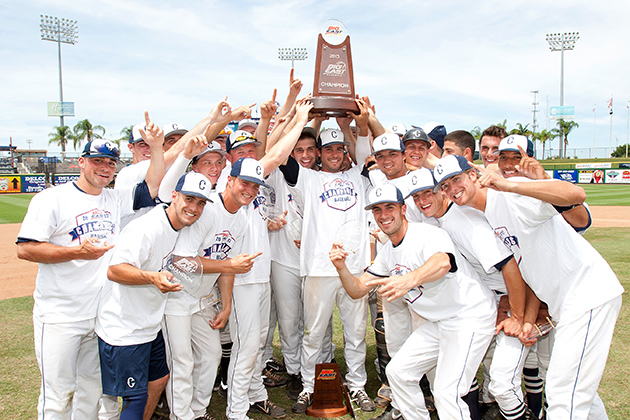 UConn's baseball team celebrates winning the Big East title for the third time, the first since 1994. (Steve Slade '89 (SFA) for UConn)