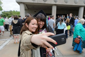Michelle Lieu, right, poses for a photo with her friend Chun Yu of Newington following the Neag School of Education commencement ceremony at the Jorgensen Center for the Performing Arts on May 12, 2013. (Peter Morenus/UConn Photo)