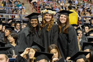 Angel Stevenson of Norwalk, left, Nicole Frisk of Glastonbury, and Amanda Barney of Wallingford at the start of the College of Liberal Arts and Sciences commencement ceremony at Harry A. Gampel Pavilion on May 12, 2013. (Peter Morenus/UConn Photo)