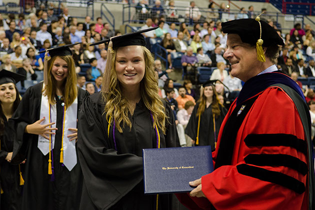 Graduates receive degrees at the School of Business Commencement ceremony held at Gampel Pavilion on May 12, 2013. (Ariel Dowski '14 (CLAS)/UConn Photo)