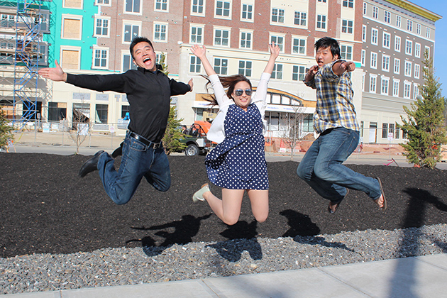 Co-owners Tom Wang, Jessica Chiep, and Ronald Liu (from left to right) pose in front of their new Asian restaurant Haru Aki in the newly constructed Storrs Center on April28, 2013. (Max Sinton/UConn Photo)