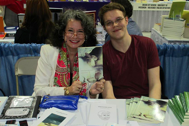 English Professor Regina Barreca holds a copy of Chronicles of a Bee Whisperer at the 2013 Association of Writers & Writing Programs (AWP) conference in Boston. Beside her is the book's author and her former student Tim Stobierski '11 (CLAS). (Photo courtesy of Regina Barreca)