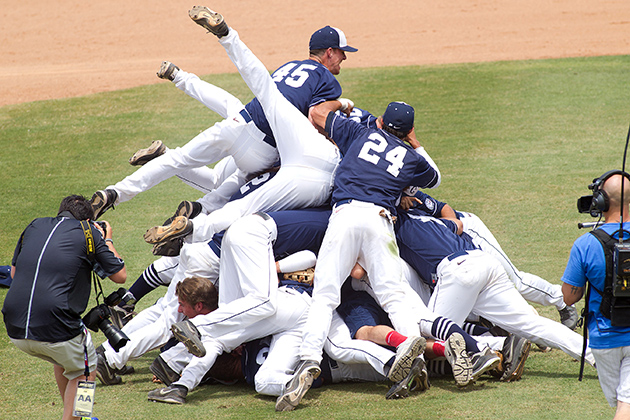 The baseball team pile up.