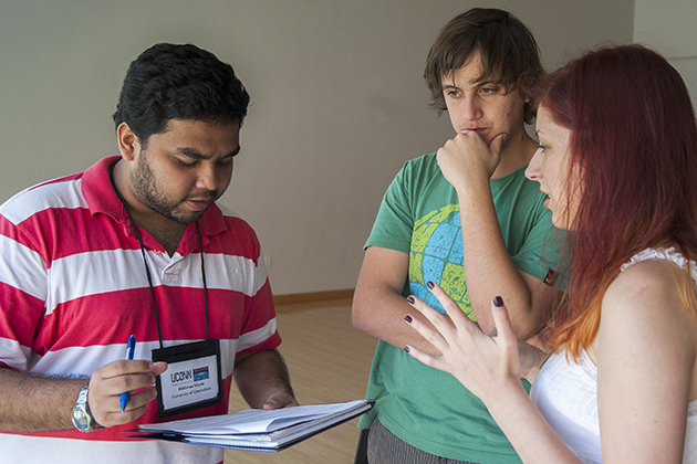 Ridhwan Shams, left, of the University of Queensland, confers with Jean Menanteau, center, Pontificia Universidad Católica de Chile, and Tzveta Dryanovska of the University of Glasgow, during the group project. (Sean Flynn/UConn Photo)