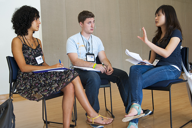 From left, Tamana Aurom, University of British Columbia, Chris Gelino, UConn, and Hye Jung Yoon, Korea University, discuss human rights issues. (Sean Flynn/UConn Photo)