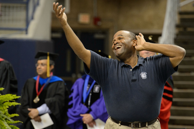 Marvin McNeill, assistant director of athletic bands leads the house in the singing of the Alma Mater during the Convocation ceremony at Gampel Pavilion.(Peter Morenus/UConn Photo)