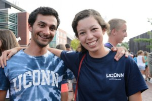 Lior Trestman '15 and Alexandra Buda '14 share 'what I did on my summer vacation' stories at the Husky Wow Barbecue. (Peter Morenus/UConn Photo)