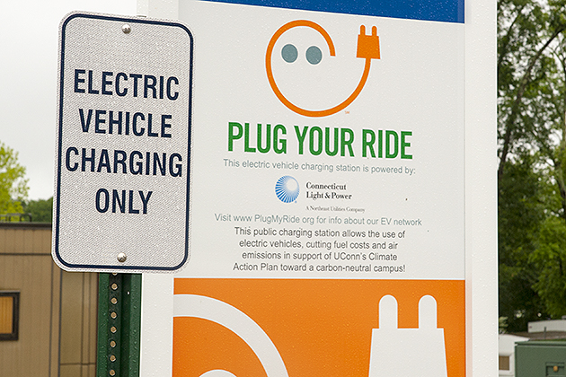 Hybrid charging station at motor pool on Aug. 9, 2013. (Sean Flynn/UConn Photo)