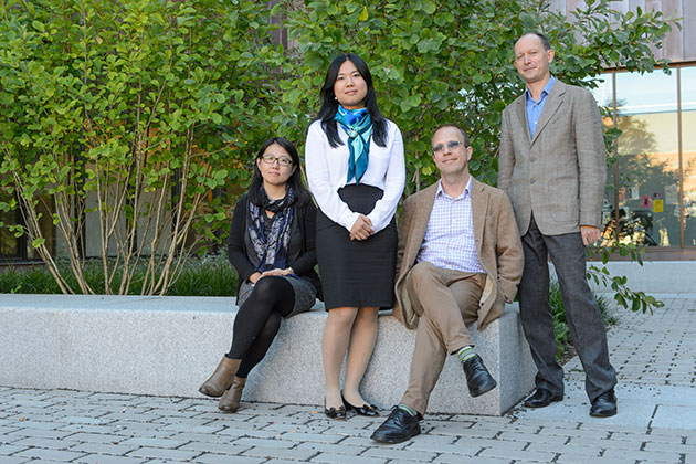 Yan Geng, assistant professor of art & art history, left, Meina Cai, assistant professor of political science, Bradley Simpson, associate professor of history, and Victor Zatsepine, assistant professor of history pose for a photo outside Oak Hall on Sept. 24, 2013. (Peter Morenus/UConn Photo)