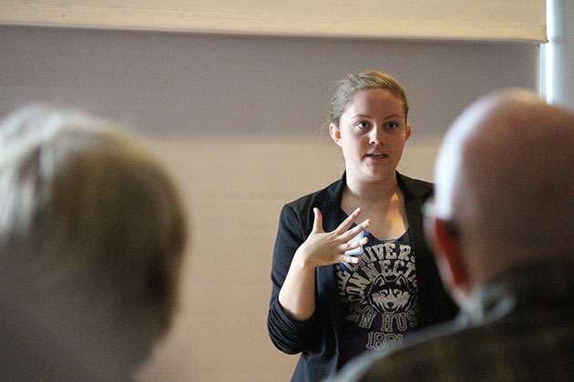 Student Amy Dellaguistina '15 (CLAS), a geography and ecology and evolutionary biology major, gives a presentation about how inexpensive foods are often the least healthy. (Christine Buckley/UConn Photo)