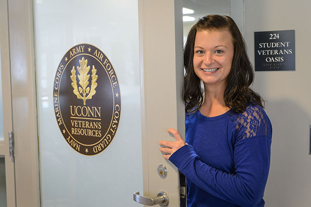 Catherine Jones '16 (CLAS) poses for a photo outside the Student Veterans Oasis at the Student Union on Oct. 22, 2013. (Peter Morenus/UConn Photo)