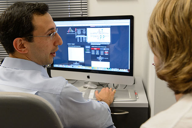 Daniel Schwartz, assistant professor of physiology and neurobiology, talks with Joey Shea '14 (ENG) about his new software. (Peter Morenus/UConn Photo)