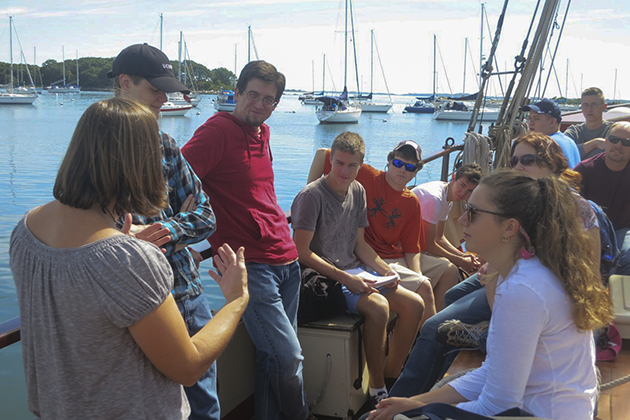 Helen Rozwadowski, left, associate professor of history and maritime studies at the Avery Point campus, explains to students on board the Mystic Whaler what the class will cover. (Nathaniel Trumbull/UConn Photo)