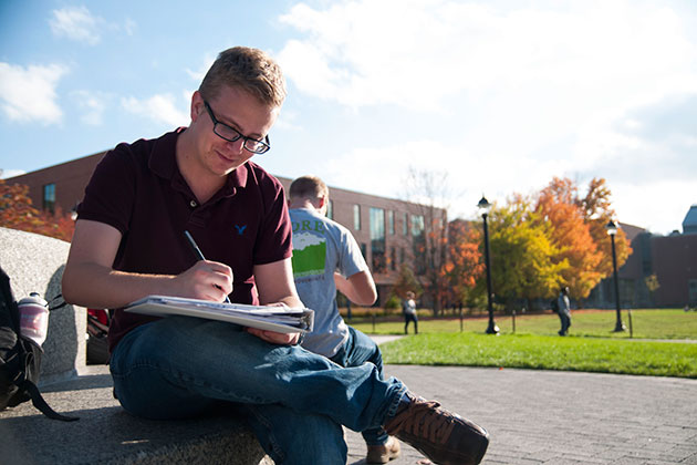 Patrick Purcell '14 (CANR) works on a design project for his landscape architecture class. (Juanita Austin '15 (SFA)/UConn Photo)