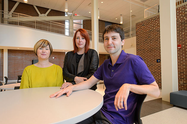 Erika Skoe, assistant professor of speech, language & hearing, left, Nicole Landi, assistant professor of psychology, and Jon Sprouse, associate professor of linguistics, at the Charles