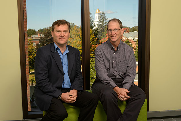 Steven Smith, assistant professor of journalism, left, and Michael Stanton, associate professor of journalism at Oak Hall on Sept. 25, 2013. (Peter Morenus/UConn Photo)