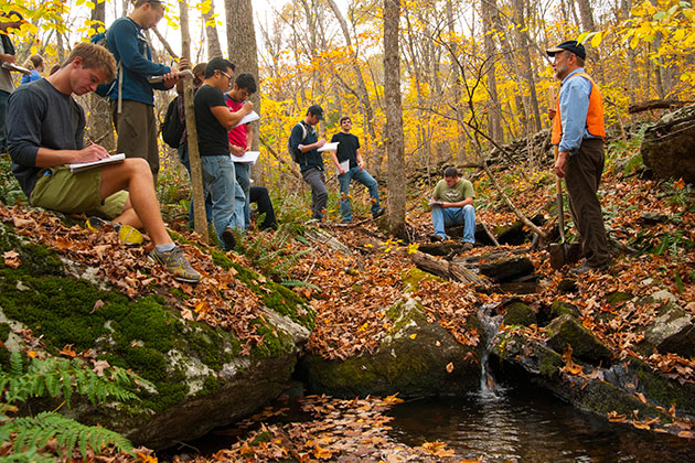 Robert Thorson, professor of ecology and evolutionary biology, teaching a class outdoors along the Fenton River. (Sean Flynn/UConn Photo)