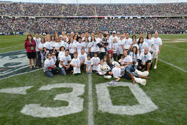 Members of the Stamos/Heerdt/Vartelas/Vlandis family pose for UConn's