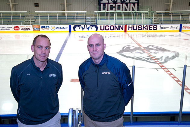 From left; Men's Ice Hockey head coach Mike Cavanaugh with Women's head coach Chris MacKenzie on Oct. 10, 2013. (Sean Flynn/UConn Photo)