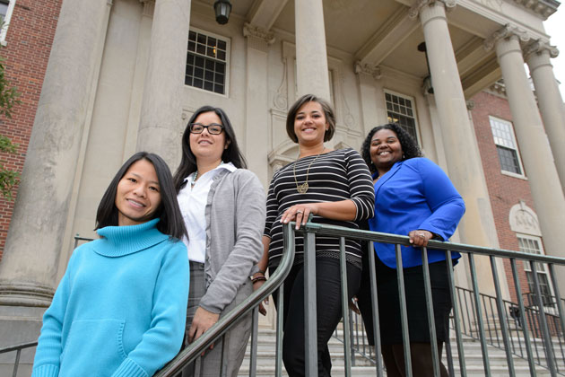 The Vice Provost for Diversity Pre-doctoral and Post MFA In-Residence Fellows, from left, Quan Tran, Melissa Huerta, Amanda Almond, and LaToya Eaves. (Peter Morenus/UConn Photo)