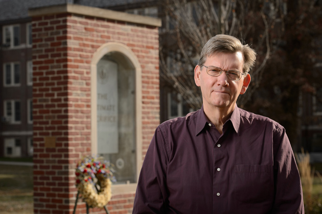 Ken Foote, head of geography, at the Ultimate Sacrifice Memorial on Nov. 15, 2013. (Peter Morenus/UConn Photo)